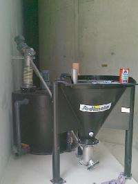 Microsand slurry system with sack-tip hopper feeding to a slurry tank
