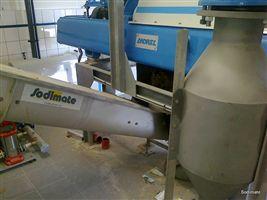 Convoyeur de reprise des boues d'épuration deshydratées par centrifugeuse