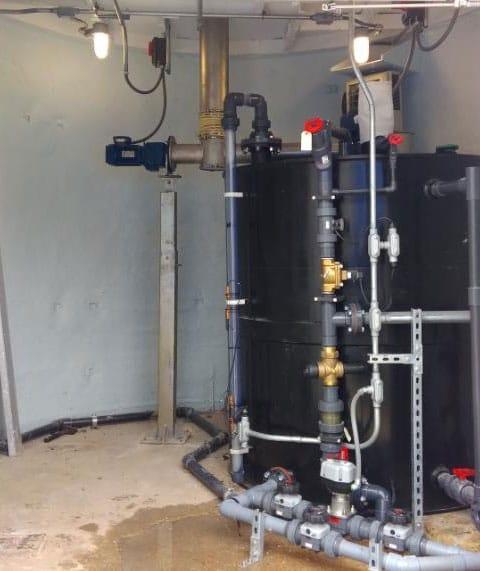 Soda ash tank installed under each silo cone