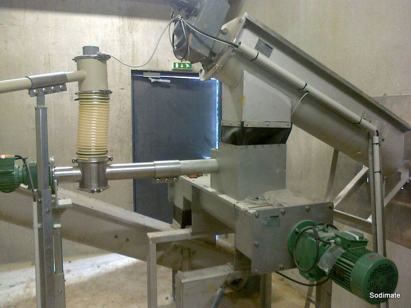 A sludge mixer blending quicklime into the material to stabilize the sludge