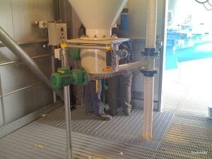 Bin Activator + dosing Screw feeding into pneumatic Conveyor